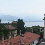 view over rooftops towards Lake Maggiore and Isola Bella