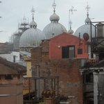 View from 2 window with domes of St. Mark's Basilica
