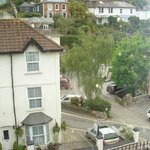 View from front bedroom window overlooking parking space, which is across the road behind the he