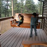 William and Evie hanging out on their favorite porch swing at our cabin