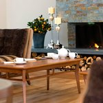 A cup of tea by the fire in the Orangery at the Inn on the Lake
