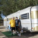My wife and I in front of our Vintage trailer!