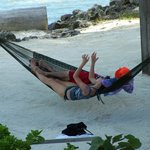 Our family enjoying the hammock on the beach
