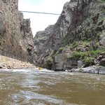 Royal Gorge Bridge above and towering granite walls.