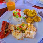 Fresh lobster served with warm butter, rice with pepper & fried banana.  Fresh squeeze mango jui