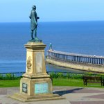 Captain Cook statue Whitby harbour near Magpie Cafe