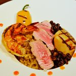 Ahi tuna,  Diver Scallop, Tiger prawn over Rissotto with Black beans