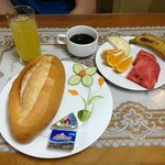 Breakfast: baguette with jam & cheese, fresh fruit