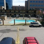 Swimming pool in middle of parking lot