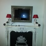 "the ""fireplace without fire"" and the painting deco tv"