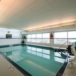 Relax at our indoor pool with a view of the city.