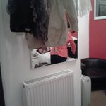 clothes hanging on a towel rail on wall