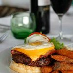 Chef's burger with garlic mayonnaise, B.B.Q sauce, ham, cheese, slow cooked onion and fried egg