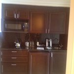 kitchenette with keurig, glassware, stove etc