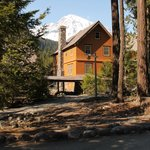 Enjoy spectacular views of Mount Rainier from comfortable chairs on our front porch