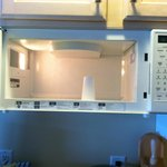 "Tiny microwave- part of ""kitchenette"""