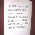 Paper sign on door of second floor stairwell/fire escape