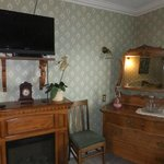 our room: remote controlled fireplace, flatscreen tv and lots of historic furniture