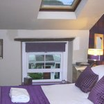 Second (third) floor room with double bed, skylight.