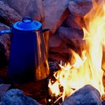 Coffee, or water for tea, tastes just a little better when heated over an open fire.
