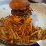 Double Burger with American, bacon, and fried egg and 1 order of fries.
