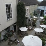 looking down on the courtyard of this historic coaching inn - now The Stables serves pizza and p