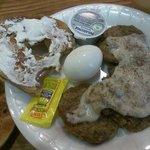 Bagel with cream cheese, boiled egg, turkey sausage patties with gravy, hot tea