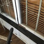 Rotting window sills on decking looking into restaurant