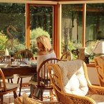 Warm and inviting, breakfast in the conservatory prepared to order.