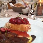 table at diner with foie gras and cherries... yum!