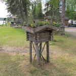 "Miniature reproduction of a ""cache"" used by early settlers to store food out of reach by bears a"