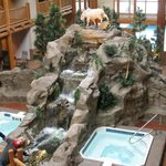 These are how the hot tubs inside look and the waterfall leads to a pool with fish in it!