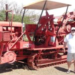 my husband by one of the sugar cane field machines