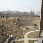 View from our Beijing Hezhong Jianguo hotel room balcony - vast compound and city at the distanc