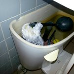 Broken Toilet/They did not fix this properly, I guess they tried fixing it with a plastic bag...