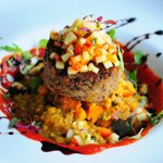 French Lentil cakes with thai coconut curry sauce and dal topped with ginger pineapple relish.