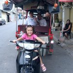 my daughter in front of hotel with friendly tuk tuk driver.