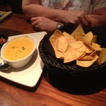 Chips, queso and salsa appetizer...chips were crisp and tasty, and the queso was smooth with jus