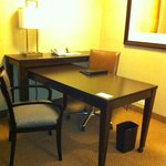 Large work desk with lots of electrical outlets
