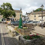 The market square in Grassington with the Black Horse hotel in the background