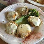 Vegetable stuffed mushrooms topped with mozzarella cheese