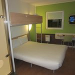 Bed with upper bunk for additional persons