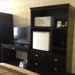 newer furniture with microwave and fridge