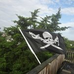 Pirate flag flying on roof top balcony