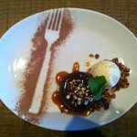 Molten chocolate cake with vanilla icecream and crunchy nuts