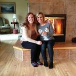 Sisters cozy by fire at Adams Street B&B
