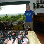 My husband with part of the Master Suite and and valley view.