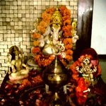 Ganesh.On the recpetion desk, and manager was doing prayers and rituals in front of it :D