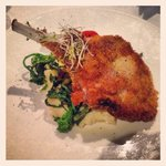 Veal Chop Milanese with mashed potatoes and vegetables