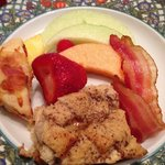 Tons of fruit, egg breadpudding casserole, savory scone & maple bacon!